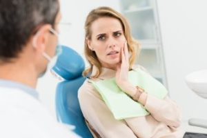 Dental patient in pain before seeing emergency dentist in Orlando