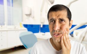 Distressed man in pain before seeing an emergency dentist in Orlando